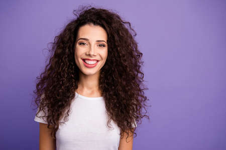 Close up photo amazing beautiful gladly modern her she lady long wave wealth hair toothy beaming smile wearing casual white t-shirt clothes outfit isolated violet purple bright background Imagens - 120484624