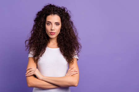 Close up photo beautiful her she lady self-confidently look arms crossed clever freelancer worker work job professional wear casual white t-shirt clothes outfit isolated violet purple background Stock Photo