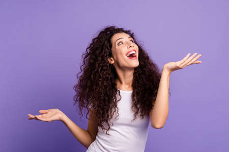Close up photo beautiful amazing her she lady scream yell shout look up empty space both arms show products higher lower wear casual white t-shirt clothes outfit isolated violet purple background