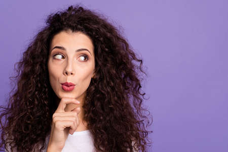 Close up photo funky beautiful her she lady hold arm hand chin look side empty space think over oops I did it again face wear casual white t-shirt clothes outfit isolated violet purple background