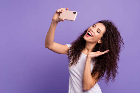 Portrait of her she nice attractive winsome lovely cheerful cheery funny girlish wavy-haired lady making taking selfie good day isolated on bright vivid shine violet pastel background