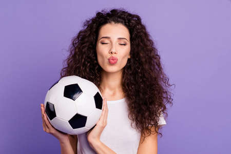 Close-up portrait of her she nice cute charming lovely winsome lovable attractive cheerful cheery wavy-haired lady holding in hands ball isolated on bright vivid shine violet background Banque d'images - 120485215