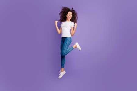 Full length body size view of nice cute lovely attractive cheerful cheery cool wavy-haired lady having fun great good day attainment isolated on bright vivid shine violet pastel background Stock Photo