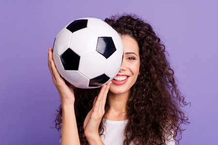 Close-up portrait of her she nice-looking cute charming attractive cheerful cheery funny wavy-haired lady holding in hand ball hiding isolated on bright vivid shine violet background Stockfoto