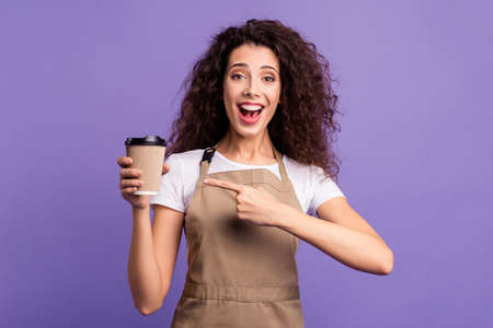 Close up photo beautiful amazing her she lady owner cafeteria hold indicate direct hand arm paper cups hot beverage invite visit cafe wear casual white t-shirt apron isolated violet purple background