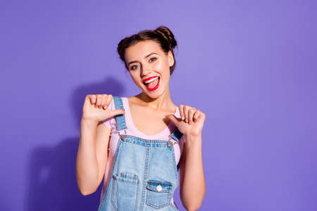 Close up photo beautiful amazing funky she her lady buns hands arms fingers directing herself I love myself wear casual t-shirt jeans denim overalls outfit clothes isolated purple violet background 스톡 콘텐츠