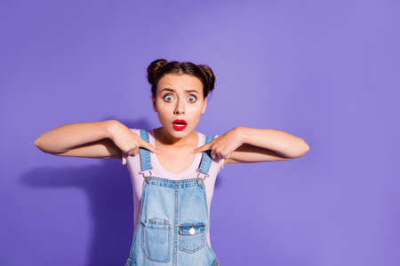 Close up photo beautiful amazing she her lady buns hands arms fingers directing herself oh no fault guilty wear casual t-shirt jeans denim overalls outfit clothes isolated purple violet background
