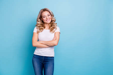 Close up photo beautiful attractive her she lady arms crossed pretty dimples cheeks cheekbones self-confident look wear casual white t-shirt jeans denim clothes outfit isolated bright blue background