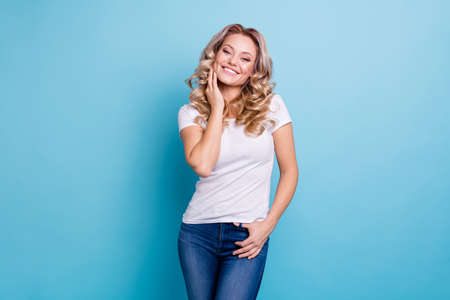 Close up photo beautiful attractive her she lady arms crossed dimples cheeks cheekbones self-confident sweet look wear casual white t-shirt jeans denim clothes outfit isolated bright blue background