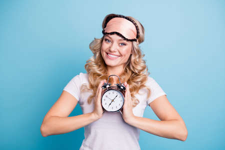 Portrait of her she nice lovely attractive cheerful cheery wavy-haired lady holding in hands retro vintage clock ready countdown isolated over blue pastel background