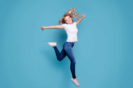 Full length body size view portrait of nice attractive cheerful cheery optimistic wavy-haired lady in casual white t-shirt having fun day running fast isolated over blue background