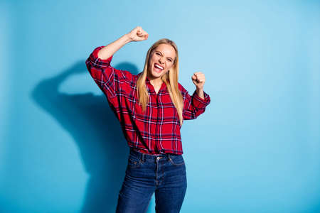Portrait of her she nice-looking charming cute lovely attractive cheerful cheery crazy lady celebrating winning isolated over teal turquoise bright vivid shine background Stock Photo