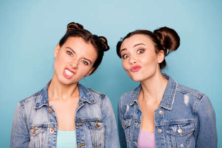 Forever children. Close up photo of cute crazy ladies students isolated making faces spending weekends vacations dressed in colorful t-shirt denim on pastel background
