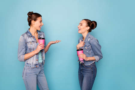 Profile side view photo of satisfied relaxing students isolated meeting speaking talking enjoying having free time dressed in denim jackets on blue background