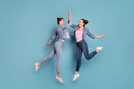 Great job Full length body size view profile side photo of cheerful excited isolated teenagers champion delighted victory scream shout yeah holidays vacation wearing denim outfit blue background