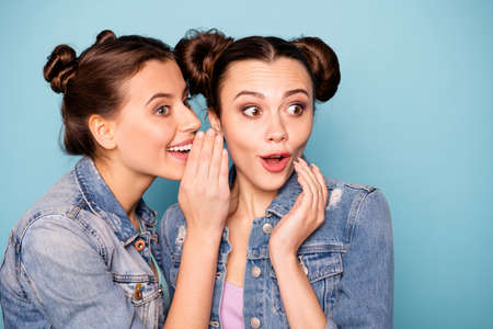 Close up photo of funny cute ladies impressed isolated sharing mysteries news unbelievable information touching chin wearing denim outifit on azure background