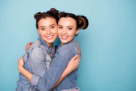 Portrait of cute charming ladies having stroll feeling romance romantic dating cuddling dressed in fashionable denim shirts over pastel background