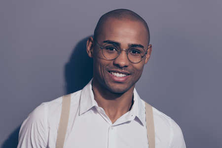 Close up photo beautiful amazing dark skin he him his macho toothy stunning manager employer collar financier boss chief shaved face wear specs pastel suspenders white shirt isolated grey background