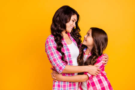 Portrait of cute charming small mature ladies feel glad relaxed motherhood parenthood concept dressed in bright trendy clothing isolated on vivid background