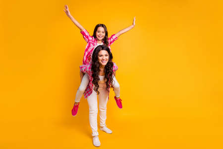 Like bird. Full length body size view photo of satisfied excited mature little family ladies have free time rest weekends funky fool playful isolated dressed in plaid shirts on yellow background