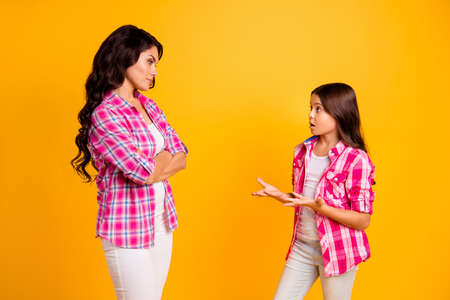 Its not me Profile side photo of disappointed irritated mom little naughty kid have disagreement feel nervous depressed stress punish explain wear checked trendy shirts isolated bright background