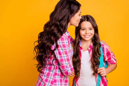 Close up side profile photo beautiful she her models ladies mom small daughter bye-bye baby kiss farewell study time see you soon wear casual pink checkered plaid shirts isolated yellow background Stock Photo