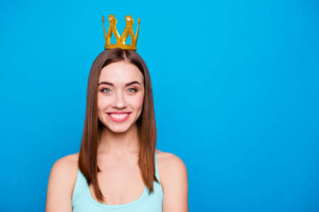 Close up photo beautiful amazing she her lady headwear head shiny glossy yellow gold crown showing presenting special status wear casual tank top outfit clothes isolated blue bright background