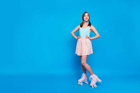 Full length body size photo funny beautiful she her lady look empty space coquettish rollers legs active way life fit body wear casual street summer pastel dress clothes isolated blue background