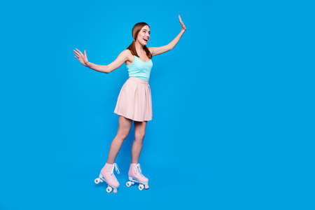 Full length side profile body size photo beautiful she her lady legs vintage rollers activity way life energetic slim body shape wear casual street summer pastel dress clothes isolated blue background