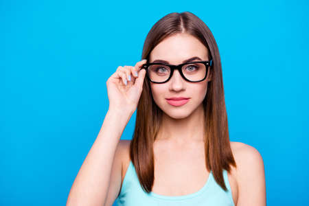 Close up photo amazing beautiful she her lady intelligence look candid eyes graduated first working day week reliable person wear specs casual tank top outfit clothes isolated blue bright background. Imagens