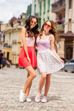 Full length body size photo of elegant magnificent cheerful teen student travel hairstyle teenagers free time enjoy posing feel satisfied dream dreamy wear fashionable skirts touch sneakers outside.