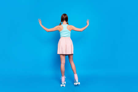 Full length back rear behind body size view photo she her lady hide face stand turned legs vintage rollers activity way life wear casual street summer pastel dress clothes isolated blue background Stock Photo