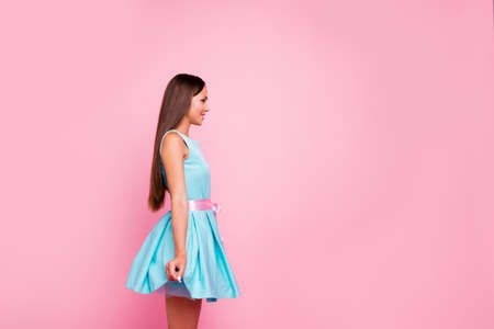 How I look Profile side view photo of attractive magnificent lady touching modern nice spring dress with ribbon feeling candid independent on rose-colored background isolated Banco de Imagens