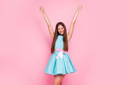 Portrait of attractive lovely lady closing eyes raising arms hands up delighted in modern spring clothing isolated on rose-colored background