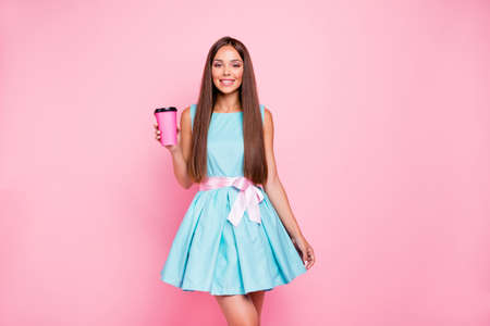 Portrait of cute charming millennial lady having wearing blue outfit with pink ribbon getting hot beverage having holiday fun isolated on pastel background Reklamní fotografie