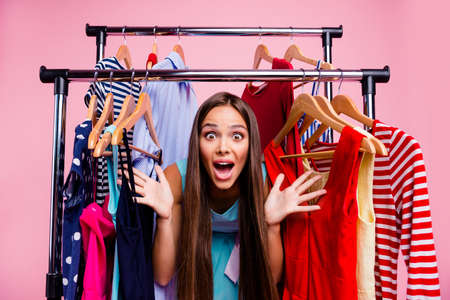 Portrait of her she nice-looking attractive winsome shine lovely crazy mad desperate straight-haired lady nothing to wear closet isolated over pink pastel background