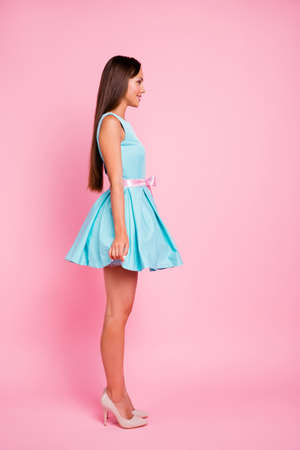 Vertical full length body size profile side view portrait of her she nice-looking attractive glamorous stunning fascinating cheerful cheery straight-haired lady isolated over pink pastel background