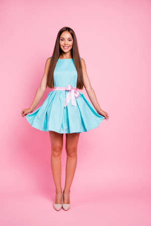 Vertical full length body size view portrait of her she nice attractive glamorous magnificent stunning fascinating cheerful straight-haired lady posing isolated over pink pastel background
