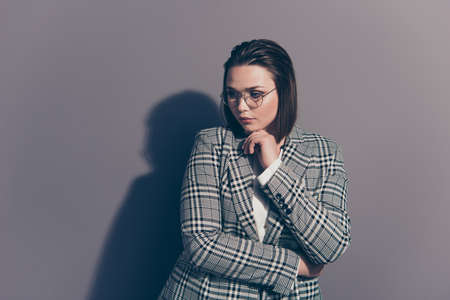 Portrait of her she nice lovely beautiful attractive classy decisive lady wearing checked blazer touching chin thinking isolated over gray violet purple pastel background Stock Photo