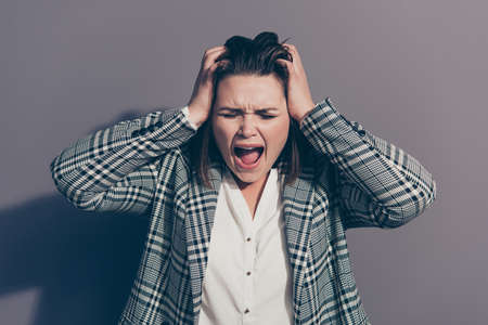 Close up photo portrait of troubled terrified scared afraid of losing place of work screaming office staff person holding head tearing hair isolated grey background