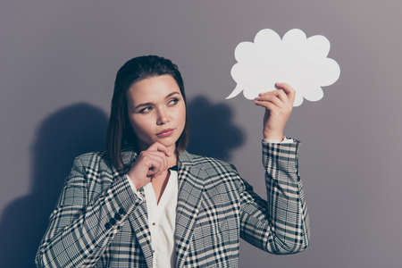 Closeup photo portrait of pretty clever intelligent smart educated office lady looking up holding white with copyspace cloud in palm isolated grey background Stock Photo