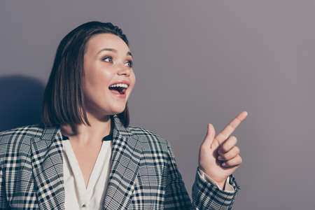 Sale discount position education concept. Close up photo portrait of cheerful funky chic funny in classic jacket office lady pointing on copy space isolated grey background Stock Photo