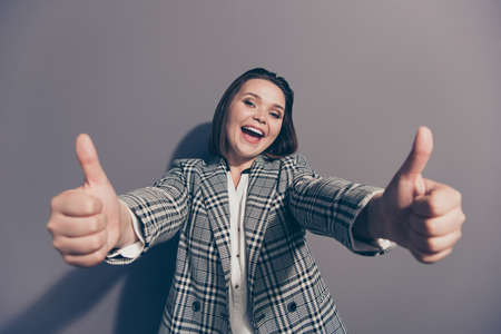 Close up view photo portrait of excited glad cool laughing carefree delightful pretty she her agent office lady making giving two likes to you camera isolated grey background
