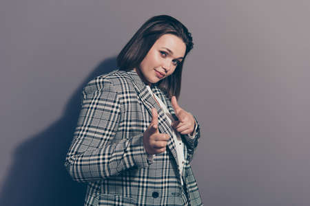 Hey I like you Closeup photo portrait of cheerful confident beautiful she her office secretary lady pointing with two forefingers on camera wearing classy checkered jacket isolated grey background