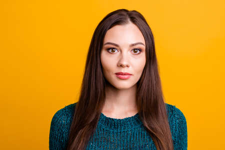 Close up photo beautiful funny funky her she lady long straight hair sincerely kind brown eyes look wearing casual dark green knitted pullover jumper clothes isolated yellow background Stock Photo