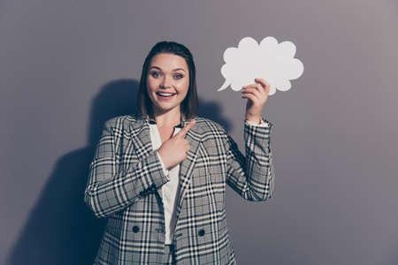 Think creative concept. Close up photo portrait of nice glad positive cute confident in thoughts office lady in plaid checkered blazer holding white empty copy place isolated grey background Stock Photo