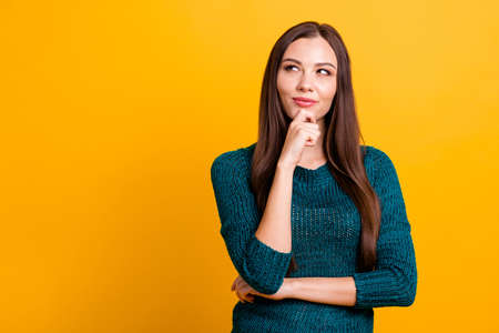 Close up photo amazing funky her she lady long straight hairdo clever brown eyes look up empty space hand arm finger chin thought wear green knitted pullover jumper clothes isolated yellow background