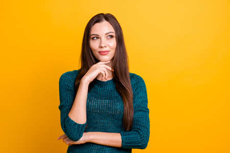 Close up photo amazing funky her she lady long straight hair brown eyes look up empty space hand arm finger chin thought wearing green knitted pullover jumper clothes isolated yellow background