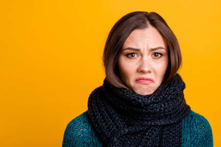 Close up photo beautiful amazing her she lady soft warm scarf around neck terrible mood cry concerned dramatic desperate wear green knitted pullover jumper isolated yellow background