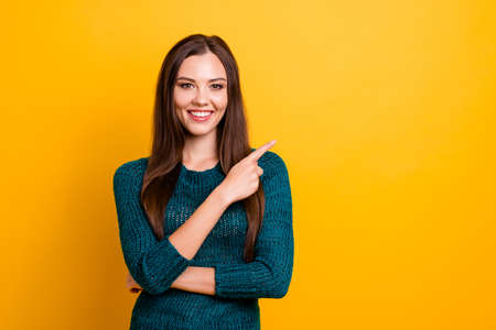 Close up photo wonderful amazing her she lady white teeth long straight hair indicate finger empty space advising buy buyer wear green knitted pullover jumper clothes isolated yellow background